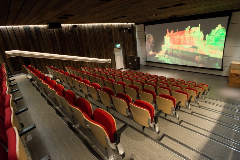 The Engine Shed auditorium with rows of red chairs and a point cloud on screen