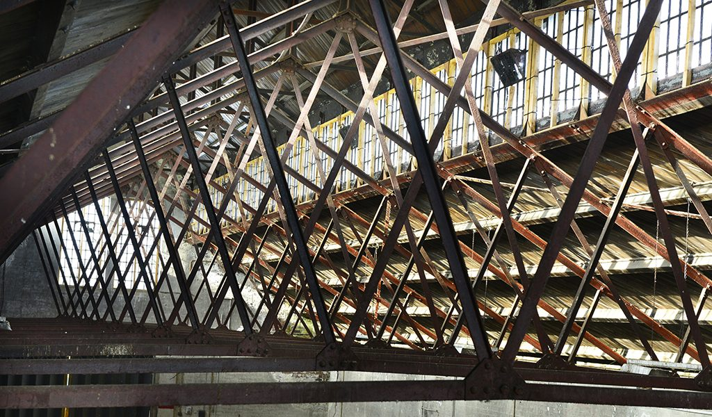 Metal trusses of a roof structure in an industrial building