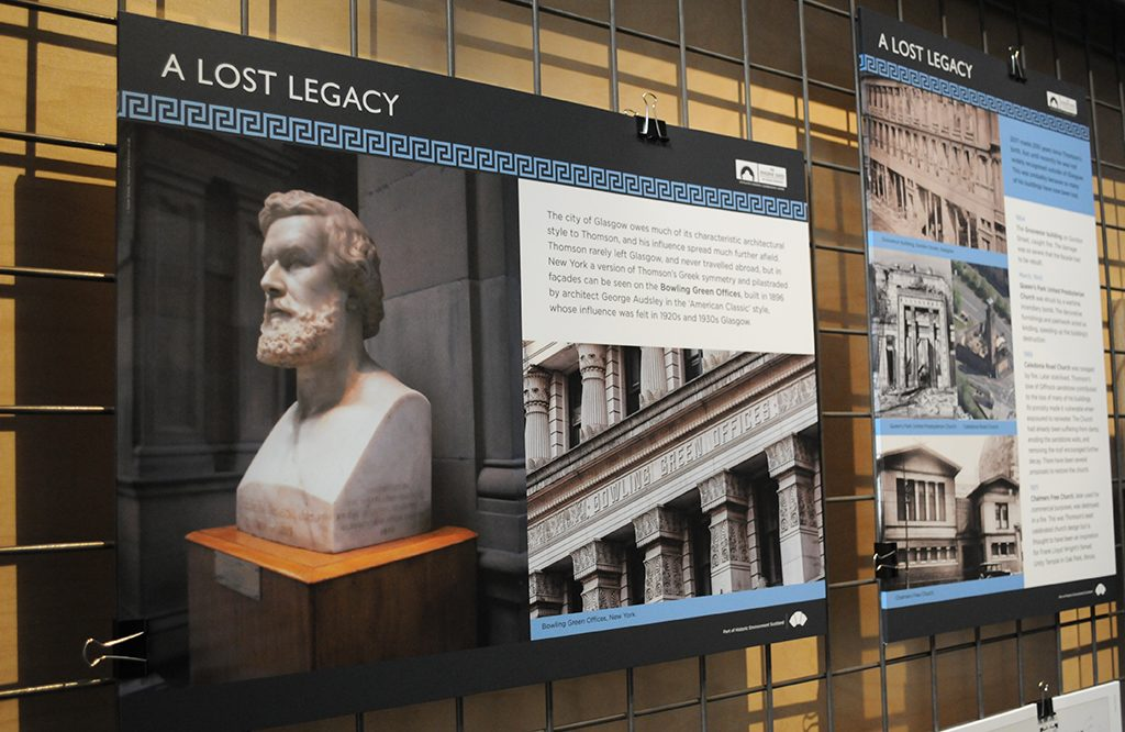 An image board in an exhibition showing a bust of Alexander Greek Thomson.
