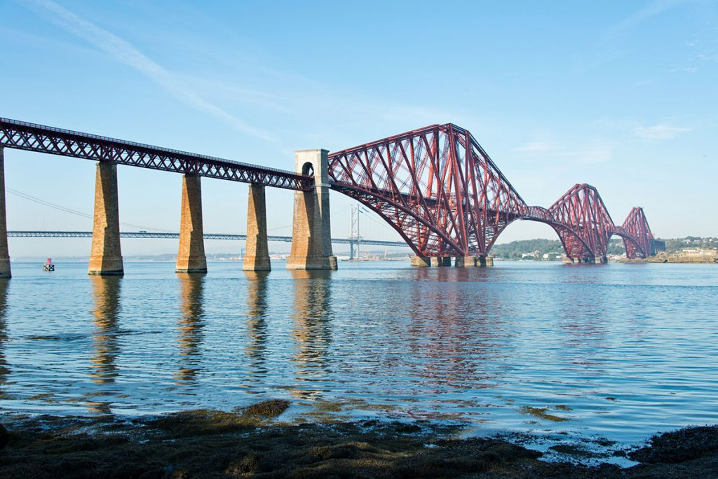 The red Forth Rail Bridge across water
