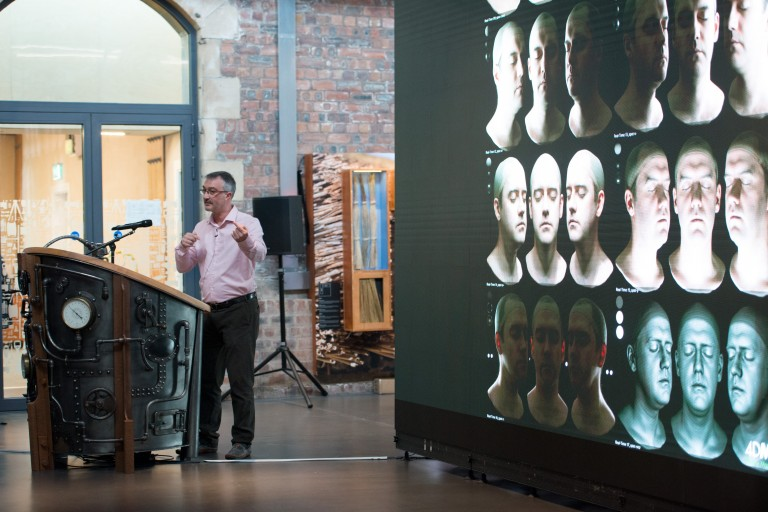 A person giving a talk at the Engine Shed