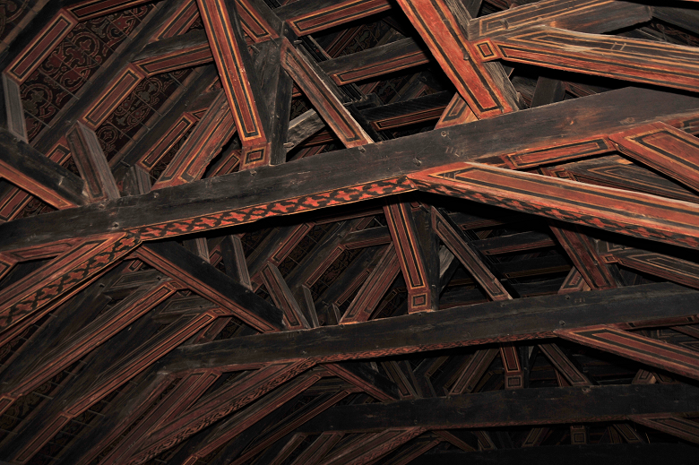 Wooden beams painted red with black designs