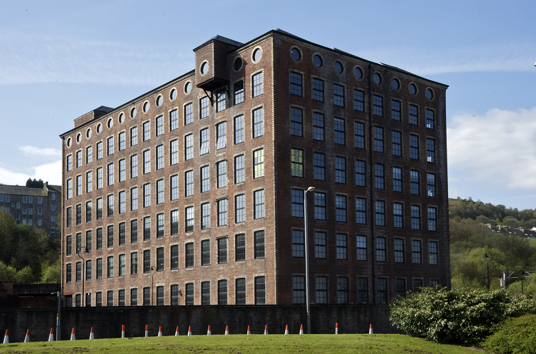 A large brick building with lots of windows