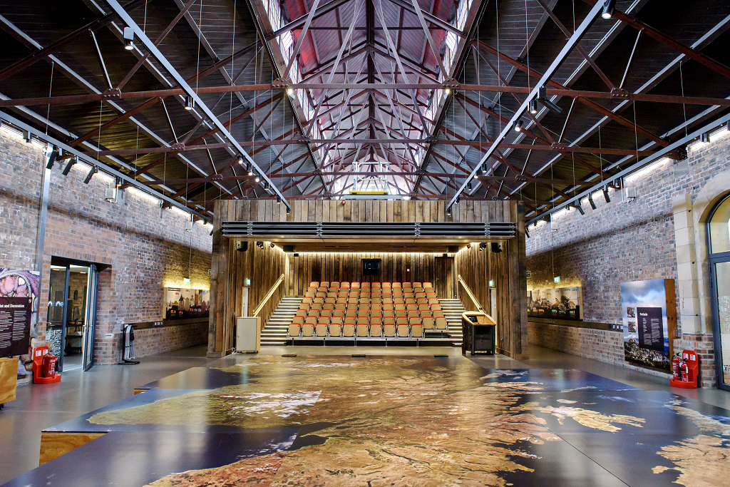 The Engine Shed main space with a giant map and open auditorium