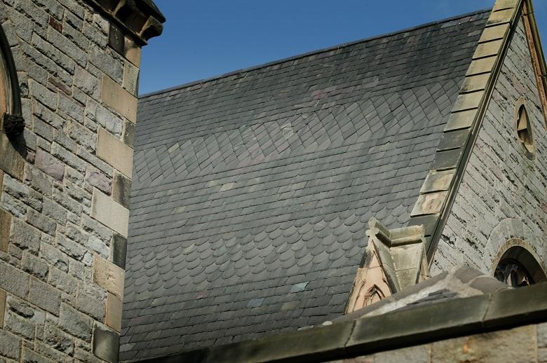 A slate roof on a historic stone church