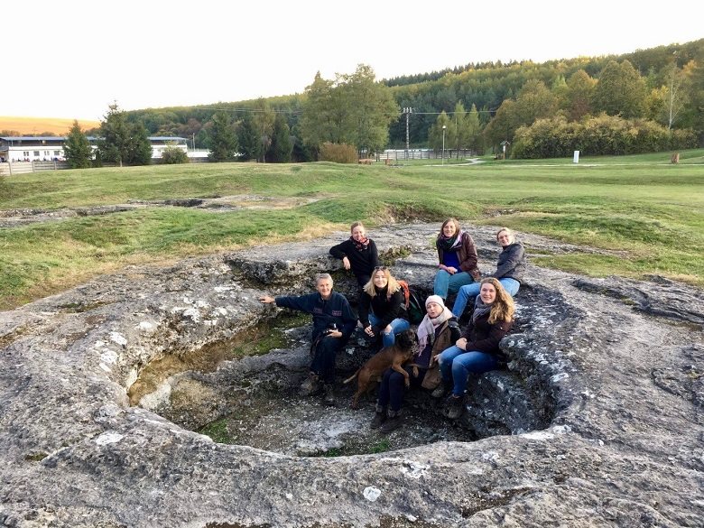 A group of people at a historic stone site