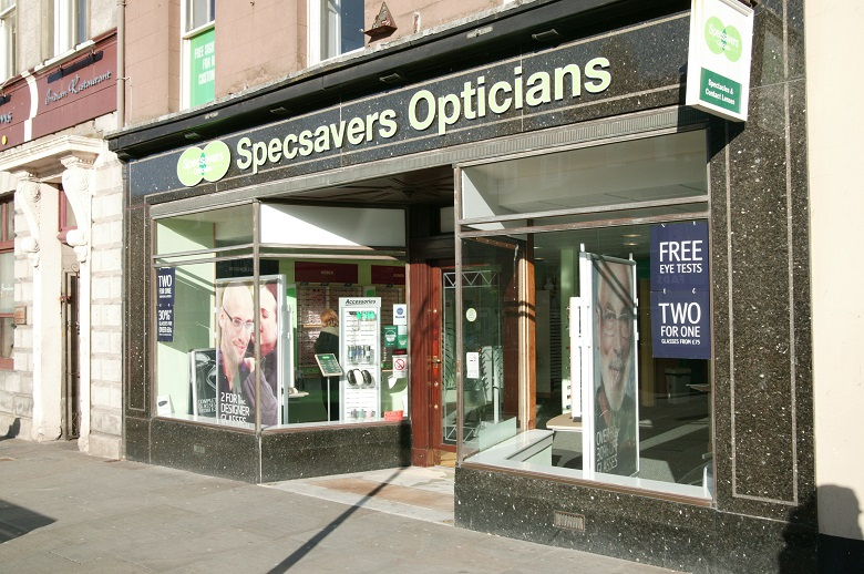 A green coloured shopfront for Specsavers Opticians