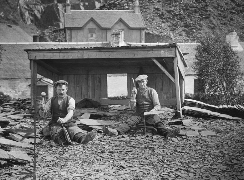 Two men splitting slate in a quarry