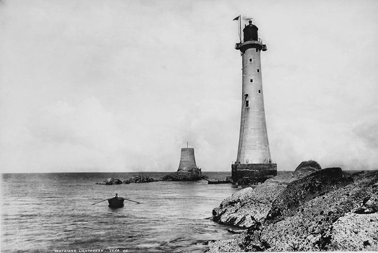 A lighthouse on the edge of the shore