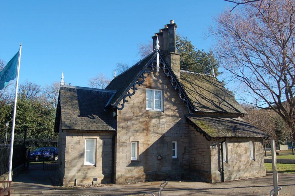 A stone lodge with a slate roof