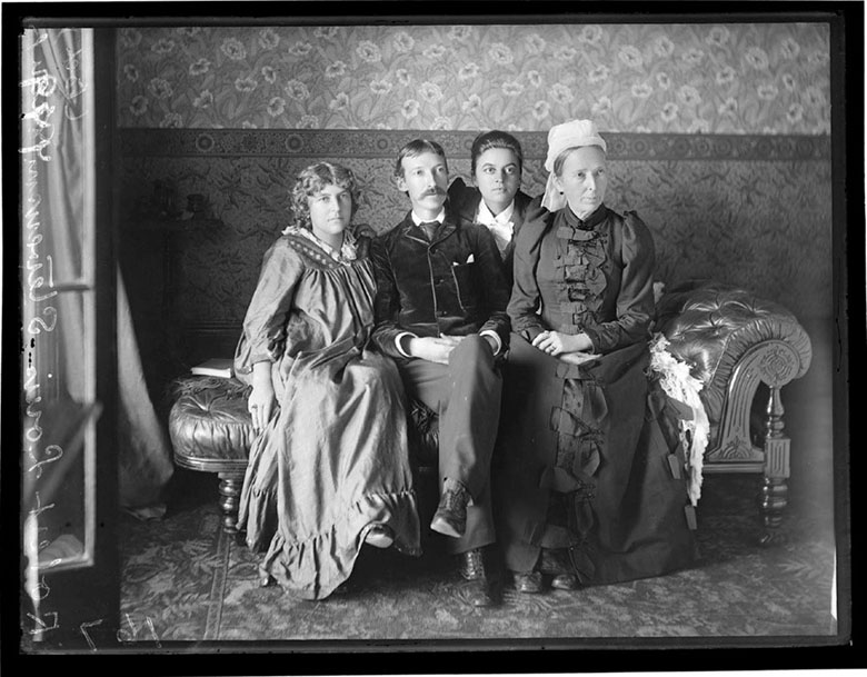 Four people sitting on a chaise longue