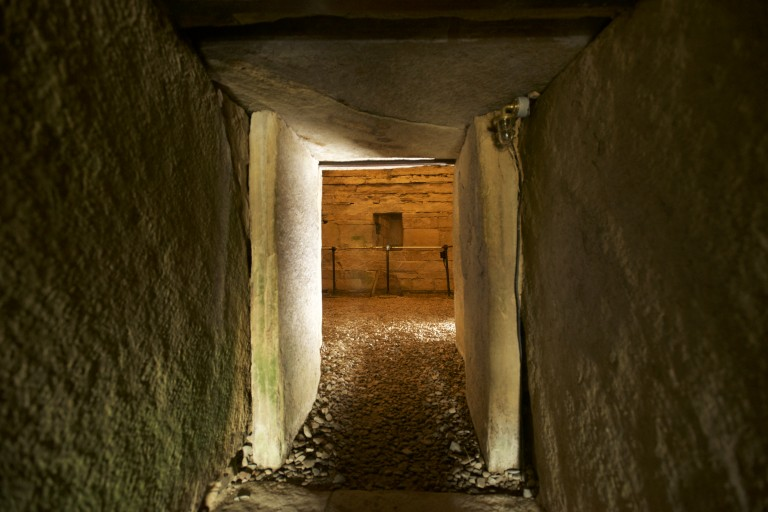 A narrow passageway into a burial cairn