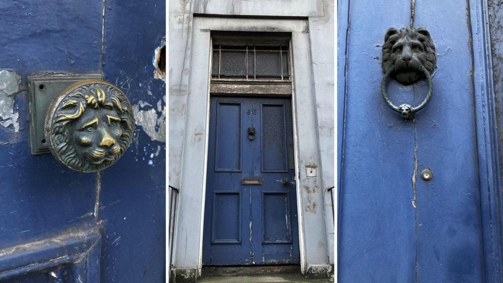 A blue tenement door, a lion door handle and a lion door knocker