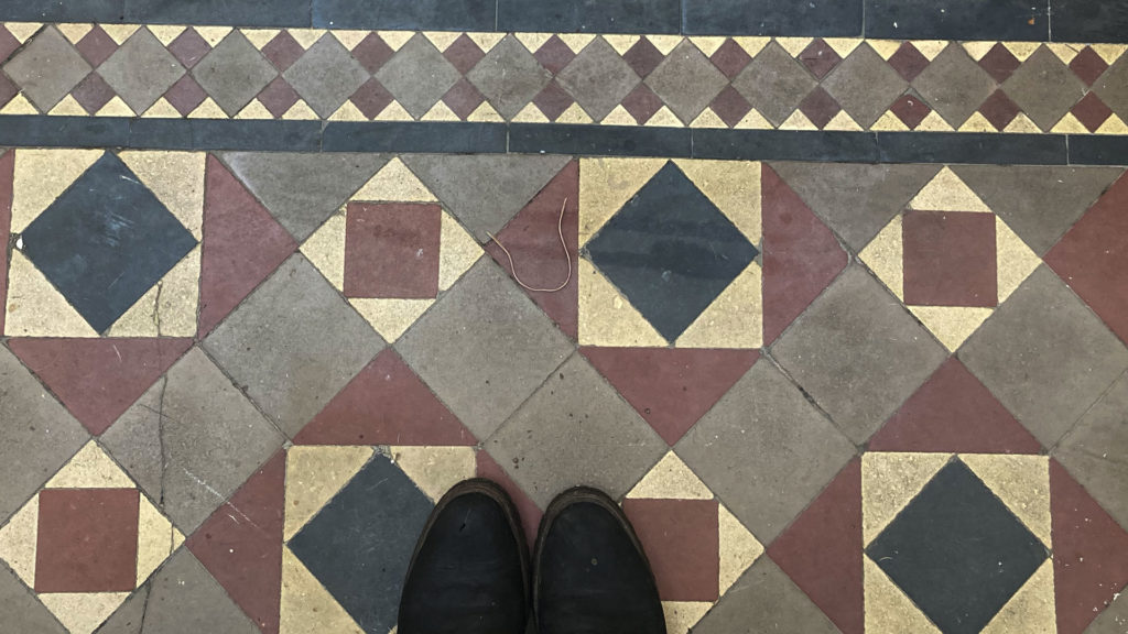A square and diamond patterned tile floor