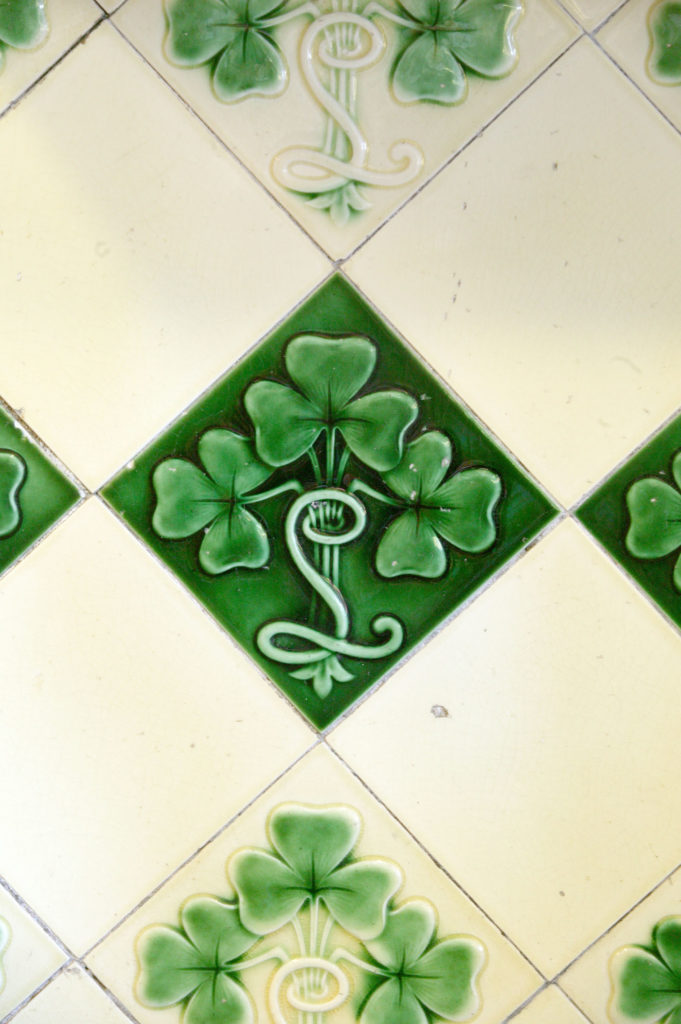 Green and white wall tiles, decorated with clovers