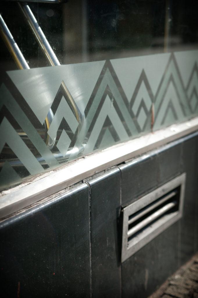 A zig zag pattern etched into a glass shopfront