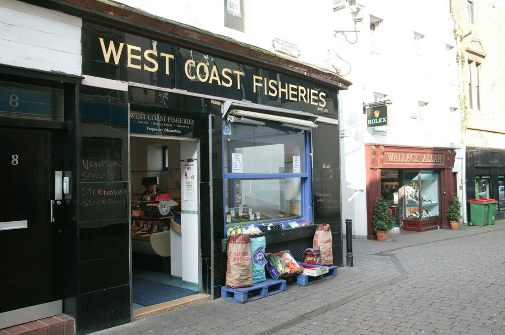 A black, glossy historic shopfront