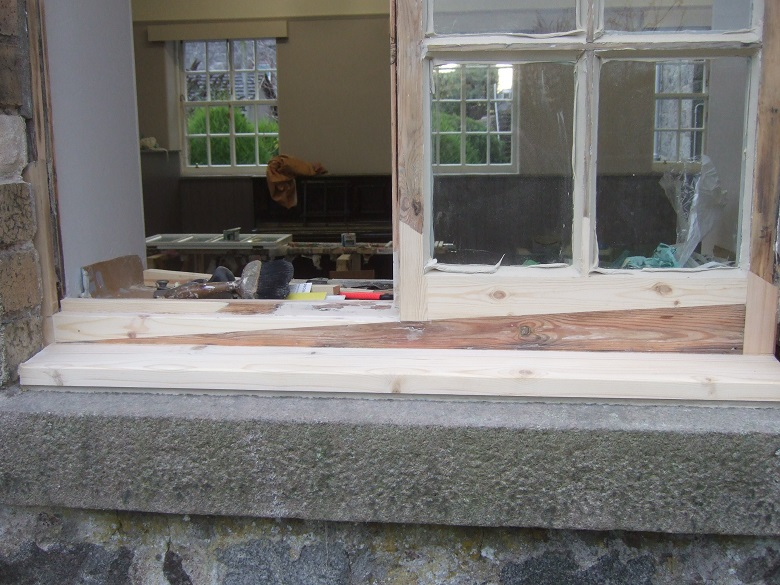 A sash and case window cill being repaired in the frame