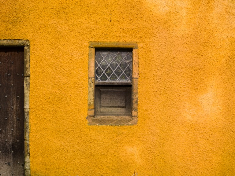 A historic building painted a bright yellow