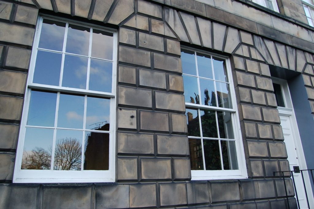 Sash and case windows in a stone tenement