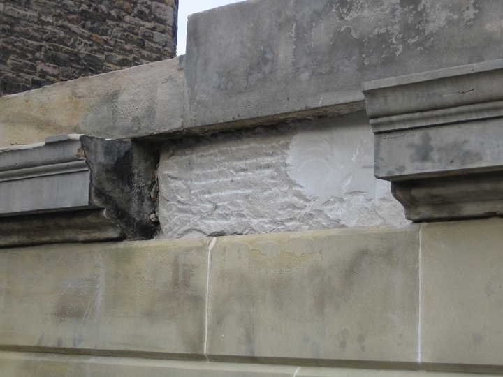 A missing piece of stone in a historic stone building